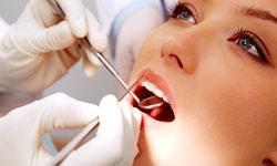 Atlanta Cosmetic Dentist, Dr. Blackburn III, performing a dental examination on a patient