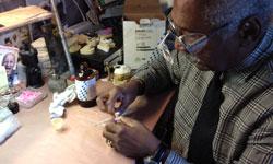 Dr. Blackburn II, Atlanta Prosthodontist, working in the office laboratory